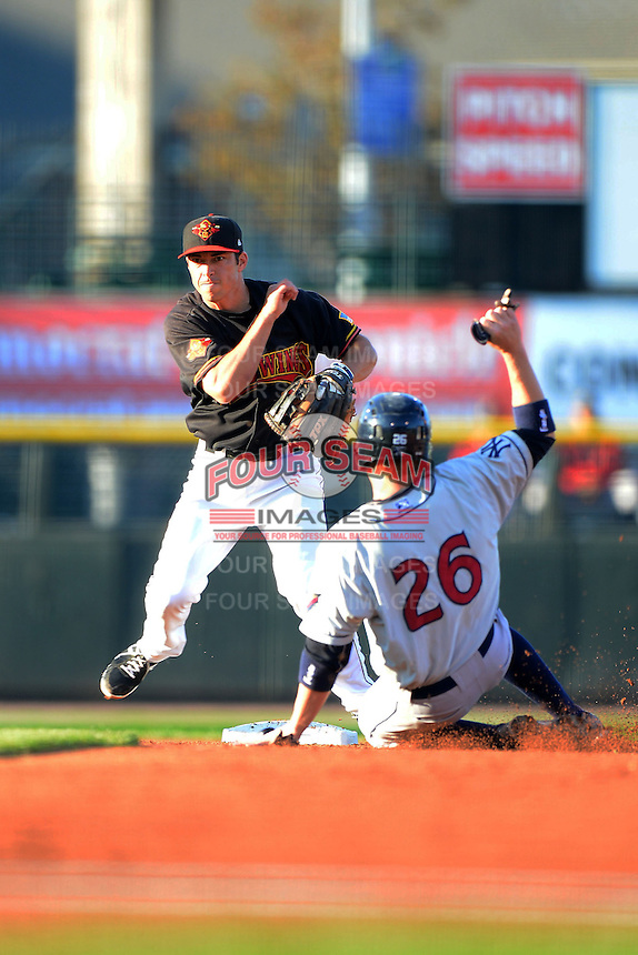 Rochester Red Wings shortstop Doug Bernier #7 attempts to turn a double play as Dan Johnson #26 slides in during a game against the Scranton Wilkes-Barre RailRiders on June 19, 2013 at Frontier Field in Rochester, New York.  Scranton defeated Rochester 10-7.  (Mike Janes/Four Seam Images)