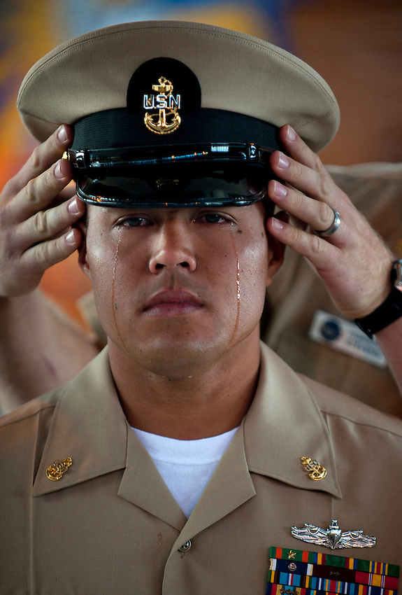 100916-N-7981E-303 .SAN DIEGO (Sept. 16, 2010) Chief Information Systems Technician Joseph Valencia, assigned to Navy Marine Corps Intranet Detachment San Diego, sheds tears as his mentor places the cover of a chief petty officer on his head for the first time during a pinning ceremony in the Fleet Logistics Support Squadron (VRC) 30 hangar at Naval Base Coronado. Twenty selectees from various San Diego area commands were pinned to the rank of chief petty officer during the ceremony. (U.S. Navy photo by Mass Communication Specialist 2nd Class James Evans/Released)