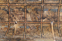 Fresco on vaulted ceiling of hall, Qasr Amra, Jordan. This fresco is divided into squares and depicts various forms of work, maybe relating to the building of the castle. These early Islamic frescoes have strong Persian and Byzantine influences. The original castle complex was built in 723-743 by Walid Ibn Yazid, the future Umayyad Caliph Walid II. It was a fortress with military garrison and residence of the Umayyad Caliphs. Today only the royal pleasure cabin remains, with reception hall and hammam or bath house. Picture by Manuel Cohen