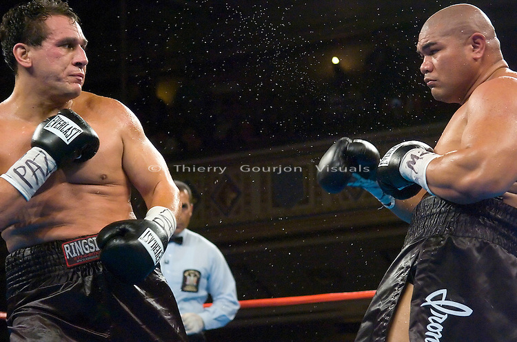 David Tua  and Ed Gutierrez both seem momentarily dazed after connecting simultaneously during their 10 rounds heavyweight fight at the Manhattan Center in NYC on 07.26.06. Tua won by a 4th round KO.