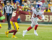 New York Giants running back Shane Vereen (34) eludes Washington Redskins free safety D.J. Swearinger (36) en route to a good gain in the first quarter at FedEx Field in Landover, Maryland on Thursday, November 23, 2017.<br /> Credit: Ron Sachs / CNP<br /> (RESTRICTION: NO New York or New Jersey Newspapers or newspapers within a 75 mile radius of New York City)