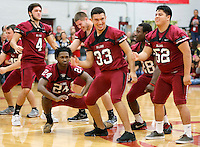 NWA Democrat-Gazette/DAVID GOTTSCHALK   Ever Galdamez (center) (33) dances with members of the Springdale High School football team Friday, November 6, 2015, during a special event pep rally at the High School. The pep rally recognized the team for last home football game of the season and ended with a Make A Wish donation to first grade student Isa Perez.