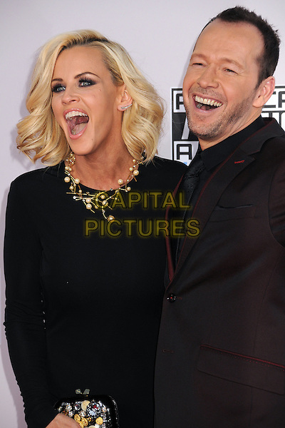 23 November 2014 - Los Angeles, California - Jenny McCarthy, Donnie Wahlberg. American Music Awards 2014 - Arrivals held at Nokia Theatre LA Live. <br /> CAP/ADM/BP<br /> &copy;BP/ADM/Capital Pictures