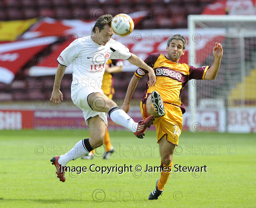16/08/2008  Copyright Pic: James Stewart.File Name : sct_jspa03_motherwell_v_aberdeen.DEREK YOUNG GETS IN FRONT OF KEITH LASLEY.James Stewart Photo Agency 19 Carronlea Drive, Falkirk. FK2 8DN      Vat Reg No. 607 6932 25.Studio      : +44 (0)1324 611191 .Mobile      : +44 (0)7721 416997.E-mail  :  jim@jspa.co.uk.If you require further information then contact Jim Stewart on any of the numbers above........