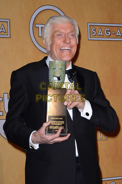 Dick Van Dyke.Pressroom at the 19th Annual Screen Actors Guild Awards held at The Shrine Auditorium, Los Angeles, California, USA..27th January 2013.SAG SAGs half length black tuxedo bow tie white shirt award trophy winner smiling .CAP/ADM/TW.©Tonya Wise/AdMedia/Capital Pictures.