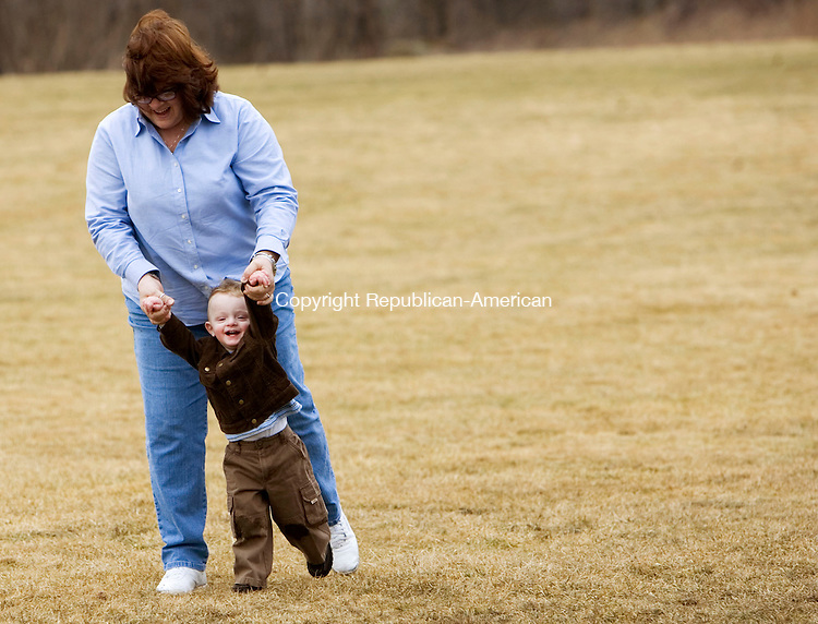 PROSPECT, CT- 13 MARCH 07- 031307JT02- <br /> Aidan Fox, 2, of Prospect, laughs as he's swung by his grandmother, Pat Prenez, of Waterbury, at Hotchkiss Park in Prospect on Tuesday.<br /> Josalee Thrift Republican-American