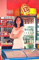 Waitress age 24 working at outdoor sidewalk bar cafe.  Torun Poland