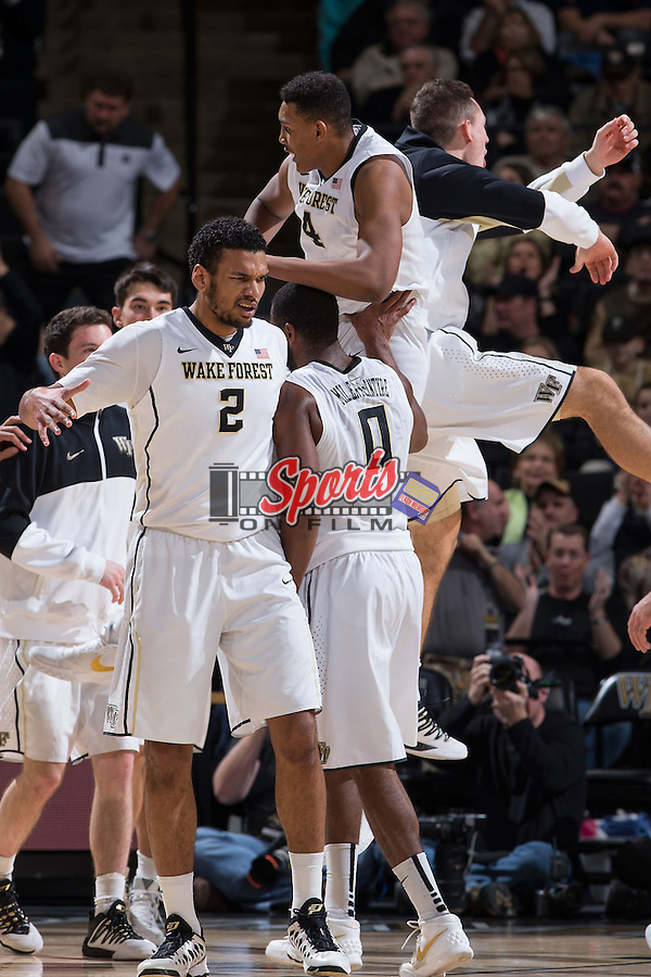 The Wake Forest Demon Deacons celebrate a play as a time out is called during first half action against the Virginia Cavaliers at the LJVM Coliseum on January 26, 2016 in Winston-Salem, North Carolina.  The Cavaliers defeated the Demon Deacons 72-71.   (Brian Westerholt/Sports On Film)
