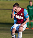 Whitehill's Aaron Somerville is distraught after shooting wide.