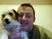 Pictured: A picture taken from open facebook account showing Robert Riley with a pet dog.<br />