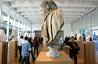 """Patrons view sculptures, including this """"Berenice"""" by an unknown Italian artist in the 1600s, during the pubic opening of Louvre Atlanta at the High Museum of Art. Over the next three years, the High Museum will feature hundreds of works of art from the Musée du Louvre in Paris."""