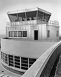 Pittsburgh PA 1953:  View of the Airport Tower and air traffic controllers at Greater Pittsburgh Airport in 1953. In 1944, Allegheny County officials proposed to expand the military airport with the addition of a commercial passenger terminal in order to relieve the Allegheny County Airport, which was built in 1926 and whose capacity was quickly becoming insufficient to support the growing demand for air travel.  The new airport, christened as Greater Pittsburgh Airport opened on May 31, 1952. The first flight occurred on June 3, 1952.