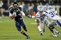 4 December 2010:  FIU running back Kedrick Rhodes (9) evades Middle Tennessee defensive end Omar McLendon (85) and linebacker Craig Allen (35) in the first quarter as the Middle Tennessee State University Blue Raiders defeated the FIU Golden Panthers, 28-27, at FIU Stadium in Miami, Florida.