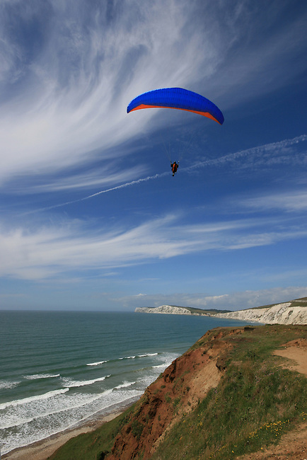 Paragliding along the south west coast of the isle of wight, above Compton Bay