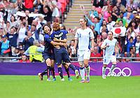 August 06, 2012..Japan's Mizuho Sakaguchi #6, Japan's Yuki Ogimi #17 and Japan's Saki Kumagai celebrate after scoring against Japan during Semi Final match at the Wembley Stadium on day ten in Wembley, England. Japan defeats France 2-1 to reach Women's Finals of the 2012 London Olympics.