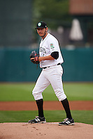 Kane County Cougars pitcher Ethan Elias (6) gets ready to deliver a pitch during a game against the Great Lakes Loons on August 13, 2015 at Fifth Third Bank Ballpark in Geneva, Illinois.  Great Lakes defeated Kane County 7-3.  (Mike Janes/Four Seam Images)