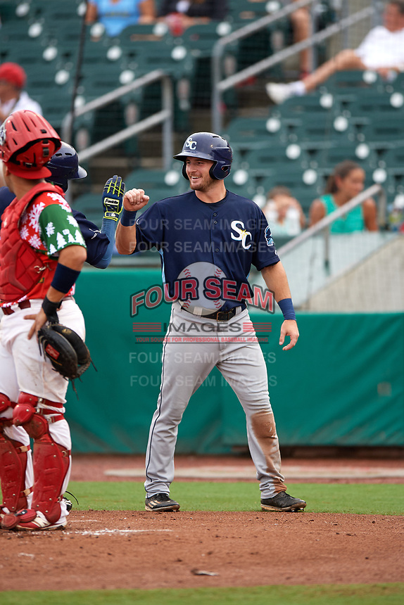 Charlotte Stone Crabs center fielder Thomas Milone (22) high fives a teammate after scoring a run during a game against the Palm Beach Cardinals on July 22, 2017 at Roger Dean Stadium in Palm Beach, Florida.  Charlotte defeated Palm Beach 5-2.  (Mike Janes/Four Seam Images)