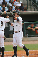 Charleston Riverdogs first baseman Tyler Austin #11 being congratulated by teammates after hitting a two-run home run during the first inning of a game against the Savannah Sand Gnats at Joseph P. Riley Jr. Park on May 16, 2012 in Charleston, South Carolina. Charleston defeated Savannah by the score of 14-5. (Robert Gurganus/Four Seam Images)
