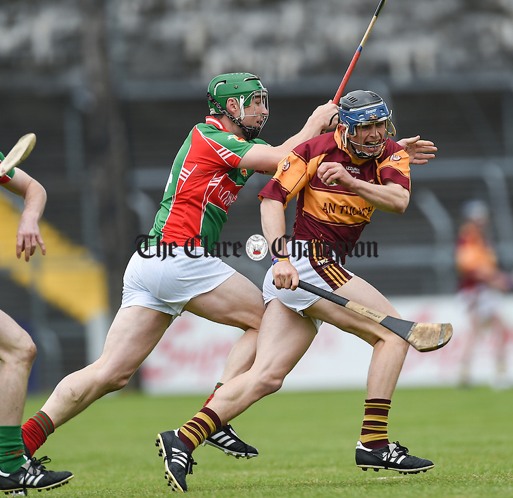 Fergal Lynch of Clooney Quin in action against David Mc Inerney of Tulla during their match in Ennis. Photograph by John Kelly.