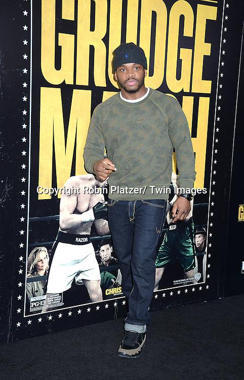 "Eddie Gomez attends the World Premiere of ""Grudge Match"" at the Ziegfeld Theatre in New Yok City on December 16, 2013."