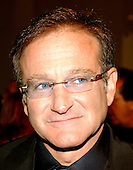 Robin Williams arrives at the John F. Kennedy Center for the Performing Arts in Washington, D.C. to honor Whoopi Goldberg, the recipient of the 2001 Mark Twain Prize for humor on October 15, 2001..Credit: Ron Sachs / CNP