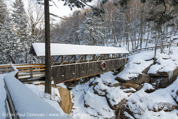 Franconia Notch State Park - Sentinel Pine Covered Bridge during the winter months. It is a footbridge which crosses over the Pemigewasset River in Lincoln, New Hampshire USA.