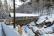 Franconia Notch State Park - Sentinel Pine Covered Bridge during the winter months. It is a footbridge which crosses over the Pemigewasset River in Lincoln, New Hampshire, USA