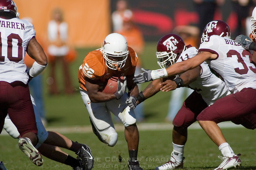 24 November 2006: Texas back Selvin Young dodges Aggie defenders during the Longhorns 12-7 loss to the Texas A&M University Aggies at the Darrell K Royal Memorial Field in Austin, TX.