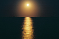 Photo of the moon rising over the Intracoastal Waterway