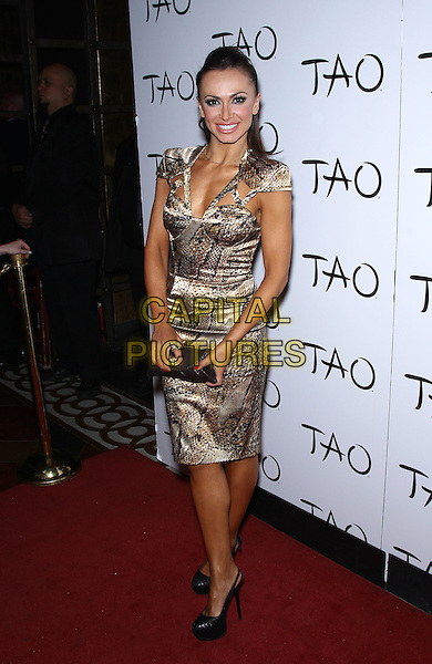Karina Smirnoff.Karina Smirnoff hosts at Tao Nightclub inside the Venetian Las Vegas, Las Vegas, Nevada, USA..June 4th, 2011.full length beige brown snakeskin animal print dress clutch bag.CAP/ADM/MJT.© MJT/AdMedia/Capital Pictures.