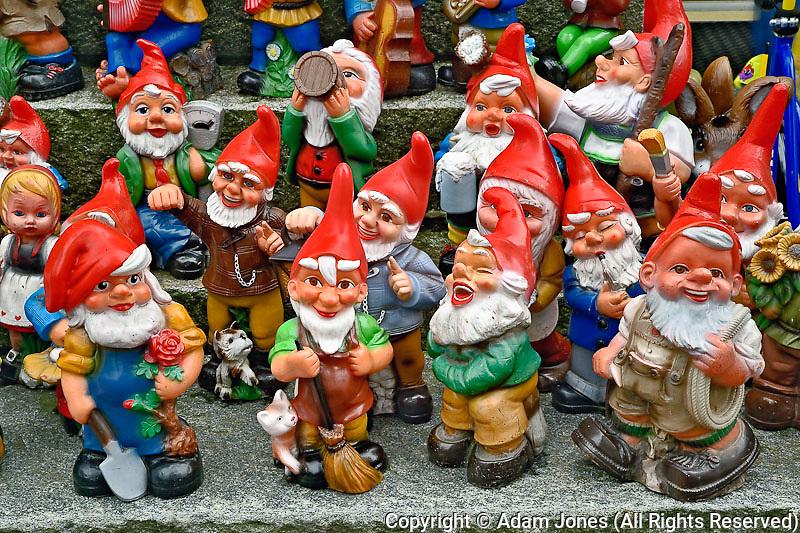Figures for sale outside shop on sidewalk. Appenzeller, Switzerland