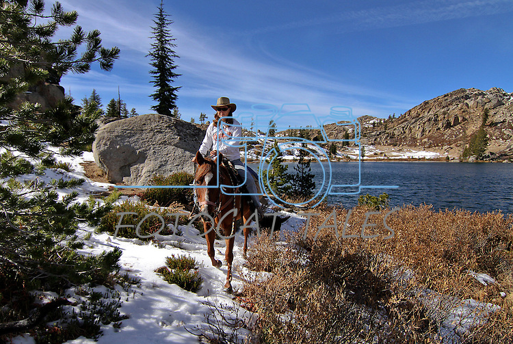 Cami rides along Granite Lake during a horseback ride above Upper Blue Lake in Alpine County, Ca. near South Lake Tahoe on Wednesday, Nov. 3, 2010. .Photo by Cathleen Allison