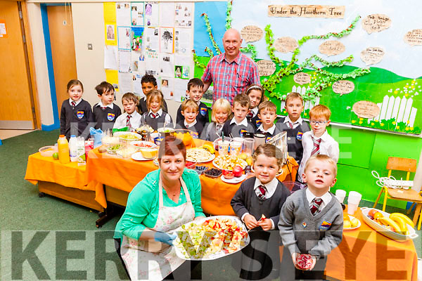 Enjoying something tasty at St Brendan's NS Fenit on Thursday as part of their Health Promotion Week were: Mags McCann (Parent and volunteer for the morning) and pupils Aoibhínn O'Sullivan and Patrick Egan. At the back l-r were: Sarah Quirke, Tom O'Sullivan, Reece O'Sullivan, Emilia Ryan, Leon Nolan, Eoghan Farrelly, Jamie Parker, Kellan Carey McGibney, Cody Deady, Bláthnaid Murphy, Riley O'Halloran Cronin, Adam Duffy, MJ Locke and with Pádraig O'Connell (Deputy Principal).