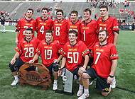 Baltimore, MD - April 28, 2018: Maryland Terrapins seniors pose with the Rivalry and Big Ten trophies after the game between John Hopkins and Maryland at  Homewood Field in Baltimore, MD.  (Photo by Elliott Brown/Media Images International)