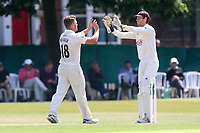 Stuart Meaker of Surrey is congratulated by his team mates after taking the wicket of Jamie Porter during Surrey CCC vs Essex CCC, Specsavers County Championship Division 1 Cricket at Guildford CC, The Sports Ground on 11th June 2017