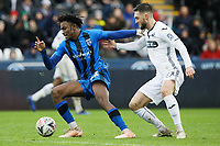 (L-R) Regan Charles-Cook of Gillingham challenged by Matt Grimes of Swansea City during the FA Cup Fourth Round match between Swansea City and Gillingham at the Liberty Stadium, Swansea, Wales, UK. Saturday 26 January 2019