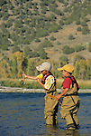 Eight- and six-year-old brothers fly fish for trout on the South Fork of the Snake River, Idaho, during a fall afternoon.