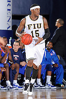12 November 2010:  FIU's Eric Frederick (15) handles the ball in the first half as the FIU Golden Panthers defeated the Florida Memorial Lions, 89-73, at the U.S. Century Bank Arena in Miami, Florida.