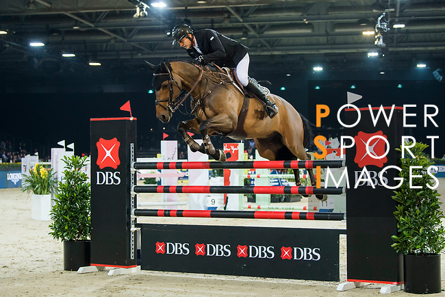 Marc Houtzager of The Netherlands riding Sterrehof's Edinus competes in the Longines Speed Challenge during the Longines Masters of Hong Kong at AsiaWorld-Expo on 10 February 2018, in Hong Kong, Hong Kong. Photo by Diego Gonzalez / Power Sport Images