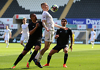SWANSEA, WALES - MARCH 25:Oli McBurnie of Swansea City is challenged by Diogo Verdasca of Porto during the Premier League International Cup Semi Final match between Swansea City and Porto at The Liberty Stadium on March 25, 2017 in Swansea, Wales. (Photo by Athena Pictures)