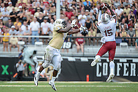 September 28, 2013 - Orlando, FL, U.S: South Carolina Gamecocks cornerback Jimmy Legree (15) intercepts a pass intended for UCF Knights running back Storm Johnson (8) during 2nd half NCAA football game action between the South Carolina Gamecocks and the UCF Knights. South Carolina defeated UCF 28-25 at Bright House Networks Stadium in Orlando, Fl