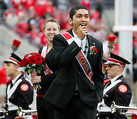 Amit Raghuvanshi reacts as he is named the 2014 Homecoming King before Saturday's NCAA Division I football game between the Ohio State Buckeyes and the Rutgers Scarlet Knights at Ohio Stadium in Columbus on Saturday, Oct. 18, 2014. (Dispatch Photo by Barbara J. Perenic)