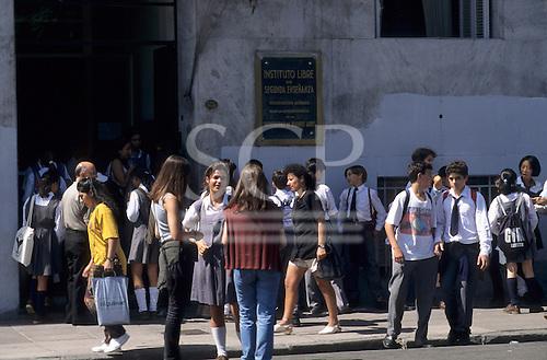 Buenos Aires, Argentina. Schoolchildren outside Instituto Libre de Segunda Ensenanza secondary school.