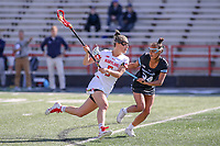 College Park, MD - April 27, 2019: Maryland Terrapins midfielder Jen Giles (5) looks to shoot the ball during the game between John Hopkins and Maryland at  Capital One Field at Maryland Stadium in College Park, MD.  (Photo by Elliott Brown/Media Images International)