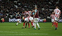 West Ham United's Andy Carroll scores his side's first goal  <br /> <br /> Photographer Rob Newell/CameraSport<br /> <br /> The Premier League - West Ham United v Stoke City - Monday 16th April 2018 - London Stadium - London<br /> <br /> World Copyright &copy; 2018 CameraSport. All rights reserved. 43 Linden Ave. Countesthorpe. Leicester. England. LE8 5PG - Tel: +44 (0) 116 277 4147 - admin@camerasport.com - www.camerasport.com
