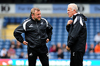 Billy Reid, assistant manager for Swansea and Alan Curtis, assistant coach for Swansea during the Sky Bet Championship match between Blackburn Rovers and Swansea City at Ewood Park in Blackburn, England, UK. Sunday 5th May 2019