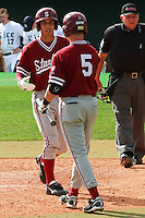 HOUSTON, TEXAS-Feb. 20, 2011:  Lonnie Kauppilla of Stanford is greeted by Zack Jones following his home run against Rice, in Houston, Texas.  Stanford defeated Rice 6-2.