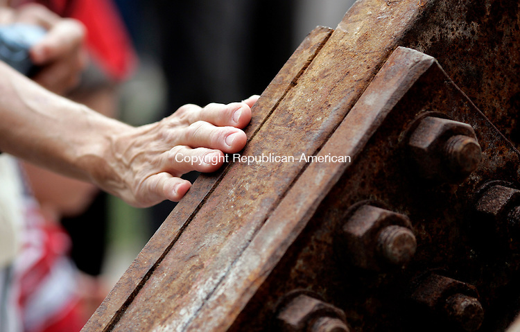 Torrington, CT- 11, September 2011-091111CM12 A woman's hand touches the steel beam at the North End Fire Station in Torrington Sunday morning.  This beam came from the World Trade Center North Lobby and will be displayed  in a memorial outside of the fire station.  Christopher Massa Republican-American