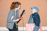 An NHPR reporter interviews audience members after Democratic presidential candidate and Massachusetts senator Elizabeth Warren speaks at Rochester Opera House in Rochester, New Hampshire, on Mon., Feb. 10, 2020. This is the final day of campaigning before voting in the primary happens on Feb. 11. Warren has fallen to 4th or 5th place in recent polls.