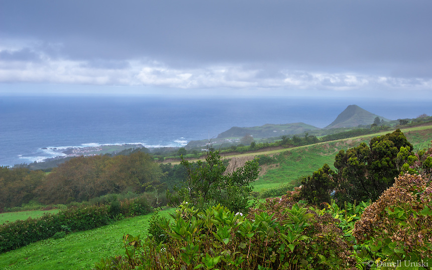Fine Art Landscape Photograph on a stormy day of the coastline of Ponta Delgada. The well watered green countryside combined well with the rich deep ocean blues of the ocean and skyline.